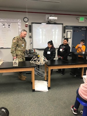 TAM Commander COL Philip Secrist shows an example of another bridge built my the daughter of a past commander. The bridge is used routinely as an example of the bridge spanning a 12-inch gap.