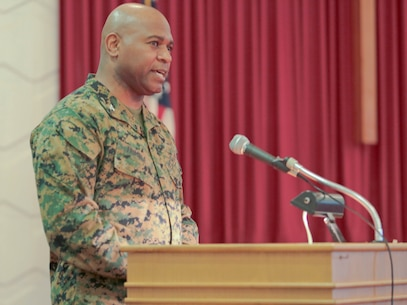 A standing-room-only crowd gathered in the Base Chapel aboard Marine Corps Logistics Base Albany for the annual Dr. Martin Luther King Jr., observance ceremony, Jan. 16.  Individuals listened intently, with varying looks of dismay, pain, shock and disbelief on their faces, as Dr. Shirley Green-Reese, one of the original Leesburg Stockade Girls, shared her story. (U.S. Marine Corps photo by Jennifer Parks)