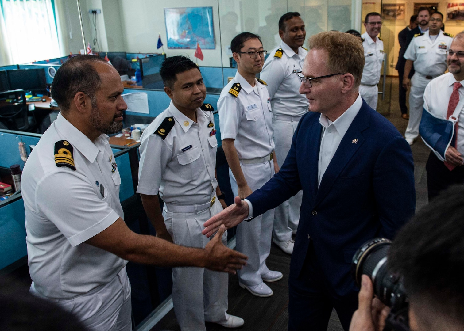 200114-N-FV739-0037\rCHANGI NAVAL BASE, Singapore (Jan. 14, 2019) Acting Secretary of the Navy Thomas B. Modly meets with international liaison officers during a tour of the Information Fusion Centre. Modly�s visit to Singapore is part of a multination visit to the U.S. Indo-Pacific areas of responsibility focused on reinforcing existing partnerships and visiting Sailors and Marines providing forward presence. (U.S. Navy photo by Mass Communication Specialist 2nd Class Christopher Veloicaza/Released)