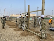 Engineers from 3rd Vertical Engineer Platoon, 643rd Engineer Support Company, install pull-up bars Jan. 14, 2020 at Balboni Field on Camp Humphreys, South Korea.