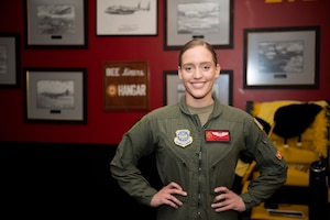 U.S. Air Force Airman 1st Class Kimberly Heiser, 21st Airlift Squadron loadmaster, stands in the squadron's heritage room Jan. 9, 2020, at Travis Air Force Base, California. Heiser was the 60th Air Mobility Wing's Warrior of the Week, a program that recognizes Airmen who have made significant contributions to their unit. (U.S. Air Force photo by Senior Airman Jonathon Carnell)