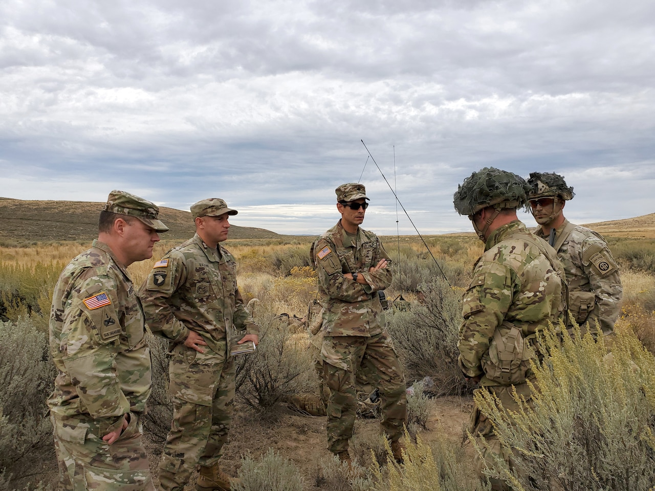 Soldiers stand in group in desert