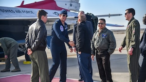 Air Force Thunderbird jet #8 pilot, Maj. Jason Markzon, meets with Aerospace Valley Air Show officials at Edwards Air Force Base, California, Jan. 16. Markzon, the advance pilot and narrator for the Thunderbirds Flight Demonstration Squadron, visited different base facilities at Edwards to conduct a site survey ahead of their performance at the 2020 Aerospace Valley Air Show, Oct. 10-11. (Air Force photo by Giancarlo Casem)