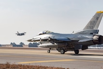 """A U.S. Air Force F-16 Fighting Falcon aircraft assigned to the 80th Fighter Squadron """"Juvats"""" taxis down the flightline at Kunsan Air Base, Republic of Korea, Jan 16, 2020. The 8th Fighter Wing is home to two fighter squadrons, the 35th FS """"Pantons"""" and 80th FS. They perform air and space control roles including counter air, strategic attack, interdiction and close-air support missions. (U.S. Air Force photo by Senior Airman Jerreht Harris)"""