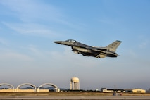 """A U.S. Air Force F-16 Fighting Falcon aircraft assigned to the 35th Fighter Squadron """"Pantons"""" takes off for a routine training flight at Kunsan Air Base, Republic of Korea, Jan. 16, 2020. The 35th FS performs air and space control and force application roles including counter air, strategic attack, interdiction and close-air support missions. (U.S. Air Force photo by Tech Sgt. Joshua Arends)"""