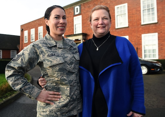 U.S. Air Force Technical Sgt. Genevieve Villela, 100th Air Refueling Wing NCO-in-charge of protocol, and Rebekah Hedstrom, 100th ARW Chief of Protocol, pose for a photo at RAF Mildenhall, England, Jan. 16, 2020. The Protocol Office is in charge of ensuring every visit and ceremony on RAF Mildenhall goes to plan according to Air Force standards. (U.S. Air Force photo by Senior Airman Brandon Esau)