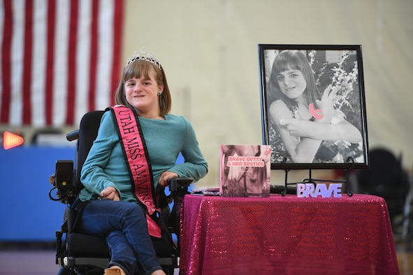 Brianna Heim, daughter of Wendy and Master Sgt. Scott Heim, 388th Maintenance Squadron, talks about her book, 'Brave Betty & Her Besties', at a base event Oct. 9, 2019, at Hill Air Force Base, Utah. Brianna was invited to write a book by Dallas Graham, founder of The Red Fred Project, which finds children living with extraordinary circumstances and asks them the question: If you could write a book for the entire world to read, what would it be about? (U.S. Air Force photo by Cynthia Griggs)