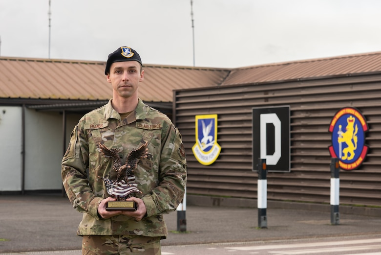 Senior Airman Christopher Francis, 100th Security Forces Squadron information assurance officer, poses for a photo with his squadron Airman of the Year award in front of the 100th SFS Jan. 15, 2020, at RAF Mildenhall, England. Francis overcame numerous challenges and an unexpected career change on his way to winning the Airman of the Year award. (U.S. Air Force photo by Airman 1st Class Joseph Barron)