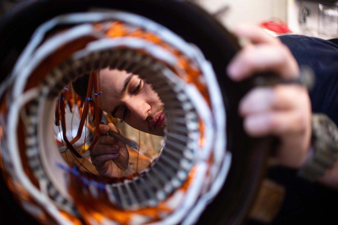 A sailor looks at a circular coil.