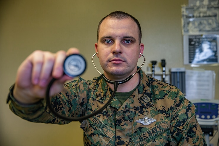Petty Officer 3rd Class Matthew Doyle, a general duty corpsman with II Marine Expeditionary Force Information Group, poses for a photo at Camp Lejeune, N.C., Jan. 14, 2020. Doyle is a native of Lowell, Mass. According to his leadership, Doyle is a selfless leader and mentor, works hard, and stays true to the Navy's core values. (U.S. Marine Corps photo by Lance Cpl. Haley Mcmenamin)