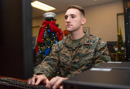 "Cpl. Joseph Kellar, a data-systems administrator with Marine Wing Support Squadron 273, Marine Wing Support Group 27, 2nd Marine Aircraft Wing, poses for a photo at Marine Corps Air Station Beaufort, S.C., Dec. 16, 2019. ""The only way to be a good leader is to lead yourself first,"" said Kellar a Ypsilanti, Mich., native. Kellar was praised by his command for moving 115 Marine Corps Enterprise Network computers in the absence of the data chief. He single-handedly re-imaged, de-issued, and replaced more than $266,000 of equipment for his command. (U.S. Marine Corps photo by Lance Cpl. Aidan Parker)"