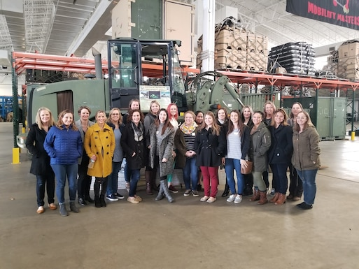 Spouses of 621st Contingency Response Wing Airmen pose for a group photo at Joint Base McGuire-Dix-Lakehurst, New Jersey, Jan. 16. The Spouse Immersion event gave spouses a chance to connect with CRW leadership and other spouses in attendance.