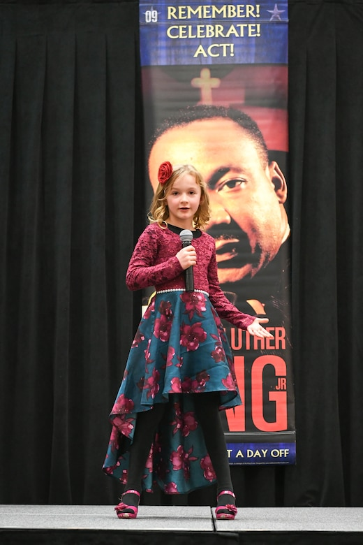 Gabriella Hayward, 2nd grader at Kaysville Elementary, delivers her speech during the Martin Luther King, Jr. Commemoration Luncheon Jan. 16, 2020, at Hill Air Force Base, Utah. Hayward is a winner from the Davis County MLK Speech Competition where they chose to deliver a famous speech by Martin Luther King, Jr. (U.S. Air Force photo by Cynthia Griggs)