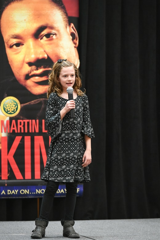 Maci Steffensen, 3rd grader at Heritage Elementary, delivers her speech during the Martin Luther King, Jr. Commemoration Luncheon Jan. 16, 2020, at Hill Air Force Base, Utah. Steffensen is a winner from the Davis County MLK Speech Competition where they chose to deliver a famous speech by Martin Luther King, Jr. (U.S. Air Force photo by Cynthia Griggs)