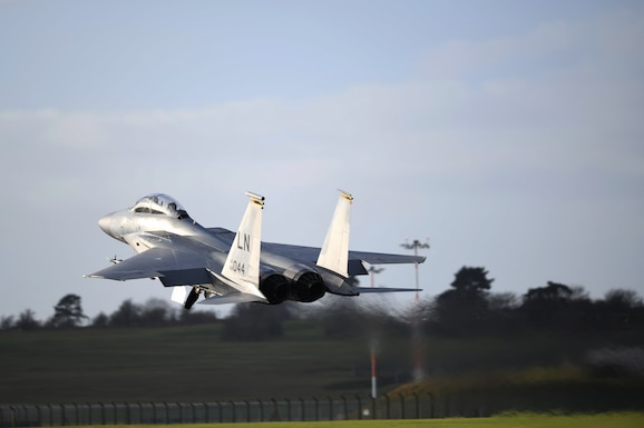 An F-15C Eagle carrying Civil Air Patrol Cadet Zane Fockler, Mildenhall Cadet Squadron cadet, takes off for a familiarization flight at Royal Air Force Lakenheath, England, January 10, 2019. Flockler was awarded the highest prestigious award in the Civil Air Patrol, the Gen. Carl A. Spaatz Award for demonstrating excellence in leadership, character, fitness, and aerospace education. (U.S.Air Force photo by Senior Airman Shanice Williams-Jones)