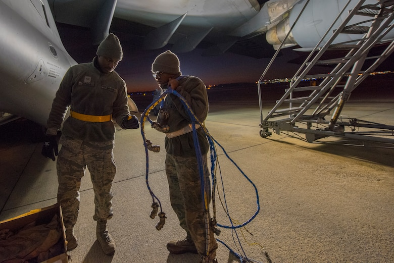 Senior Airman Markevis Duncan and Airman 1st Class George Boyd, 437th Aircraft Maintenance Squadron, aerospace propulsion specialists, pack up the old electrical wire harness from a C-17 engine Jan. 7, 2020, at Joint Base Charleston, S.C