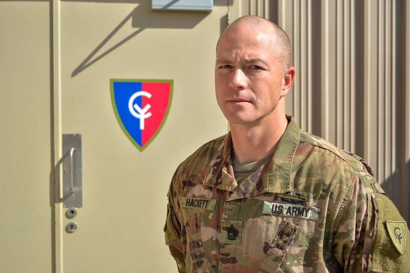 """Indiana National Guard Master Sgt. Zachery Hackett, a 38th Infantry Division senior infantry sergeant from Fort Wayne, Indiana, serving as the unit's future operations noncommissioned officer in charge, poses for a photo, Friday, Jan. 10, 2020 in the Middle East. Hackett, one of more than 600 National Guard soldiers who departed the Hoosier State in May, helps support the U.S. Army Central's Task Force Spartan in southwest Asia. """"The biggest challenges we face are the management and planning of major events Task Force Spartan in a 15- to 45-day time frame,"""" said Hackett. """"This can be challenging because of the size of formations that fall under us."""" Photo by Sgt. 1st Class Darron Salzer"""