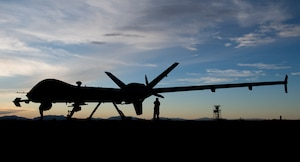 Airmen check over the first MQ-9 Reaper