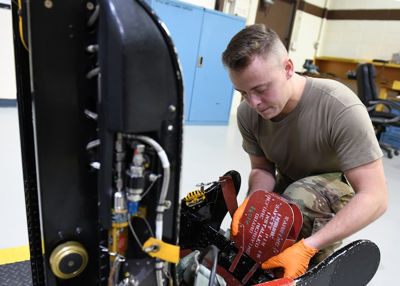Airman 1st Class Robert Dumback, 9th Maintenance Squadron aircrew egress systems journeyman, installs a D-ring guard on a U-2 Dragon Lady egress seat Jan. 14, 2020 at Beale Air force Base, California. A D-ring is the component of an egress seat that a pilot pulls to eject. The purpose of a D-ring guard is to protect the D-ring and prevent the accidental activation of an egress seat. (U.S. Air Force photo by Airman 1st Class Luis A. Ruiz-Vazquez)