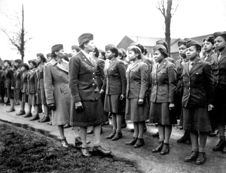 Maj. Charity E. Adams and Capt. Abbie N. Campbell inspect the first contingent of black members of the Women's Army Corps assigned to overseas service, Feb. 15, 1945, England.