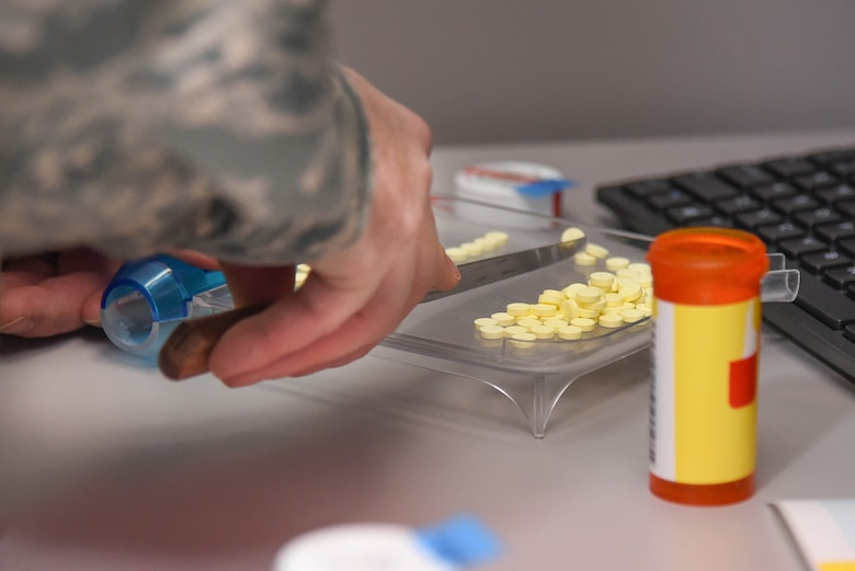 Staff Sgt. Jeff Duerson, 66th Medical Squadron pharmacy vault custodian, counts prescribed tablets before packaging them on Hanscom Air Force Base, Mass., Jan. 8. The pharmacy will be operating under limited capabilities Feb. 18 through 21 and closed Feb. 24 through 25 while the facility undergoes renovations. (U.S. Air Force photo by Todd Maki)