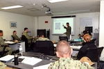 Capt. Mark Asuncion, U.S. 7th Fleet assistant chief of staff for international strategy and engagement, delivers opening remarks to Sailors attending an U.S. Indo-Pacific Command Gender in Security Cooperation Course held Jan. 14 – 15, 2020 on Commander, Fleet Activities Yokosuka. The course was developed in response to the need for comprehensive education on Women, Peace & Security (WPS) within U.S. Indo-Pacific Command theater and meets training requirements outlined in the U.S. WPS Act of 2017 and U.S. strategy on WPS.
