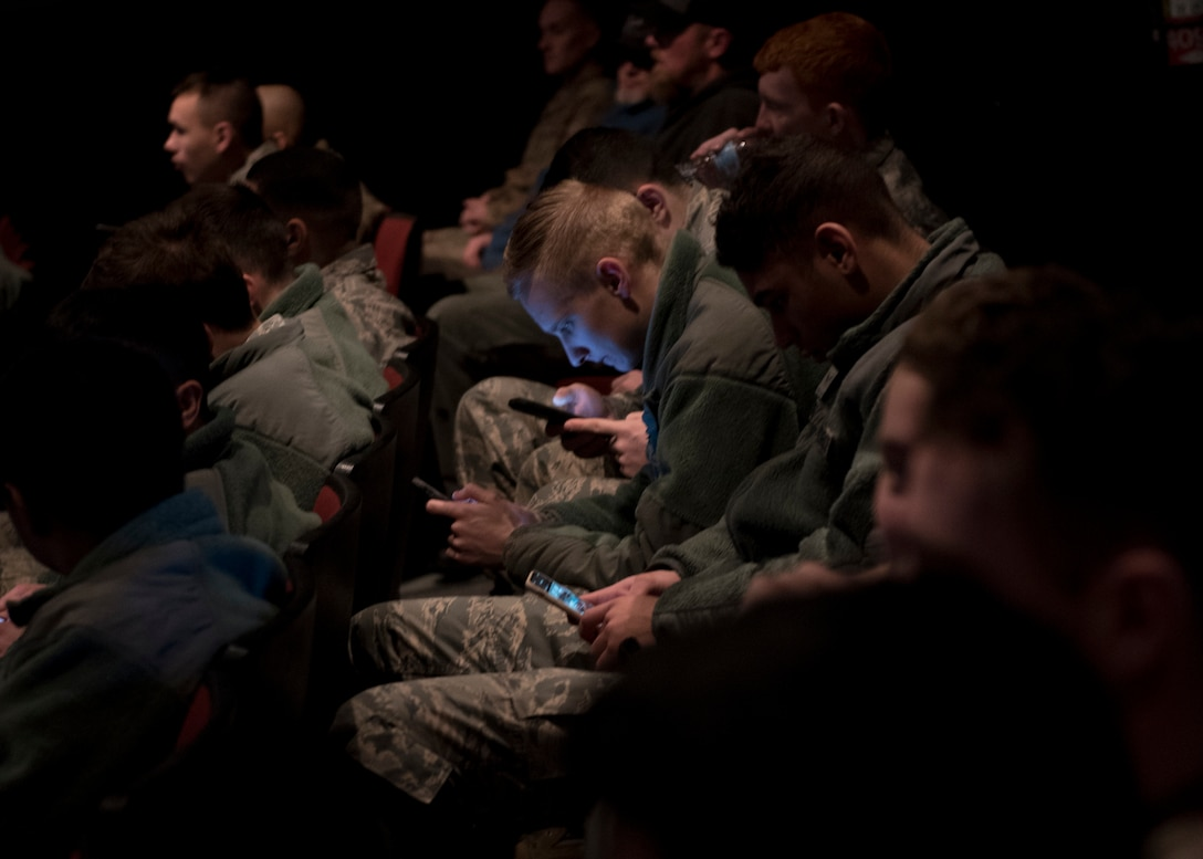 Airmen attending an all-call meeting connect to the online presentation via personal smart phones at Fairchild Air Force Base, Washington, Jan. 15, 2020. First pioneered at the base in 2017, connecting meeting attendees via smart devices helps commanders engage with large groups of Airmen in real time though polls, quizzes, feedback and questions. (U.S. Air Force photo by Staff Sgt. Ryan Lackey)