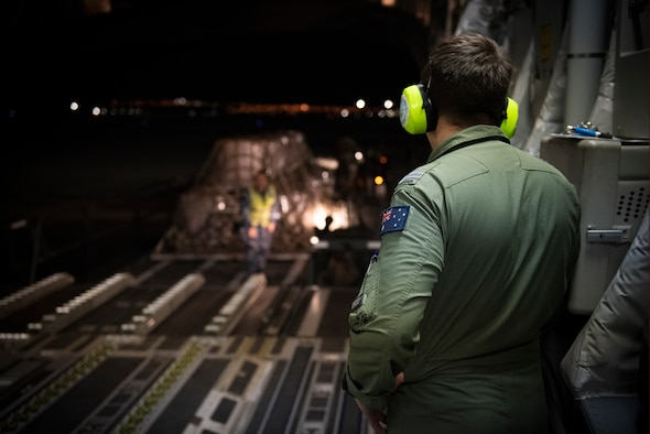 RAAF Airman watches aircraft being loaded.