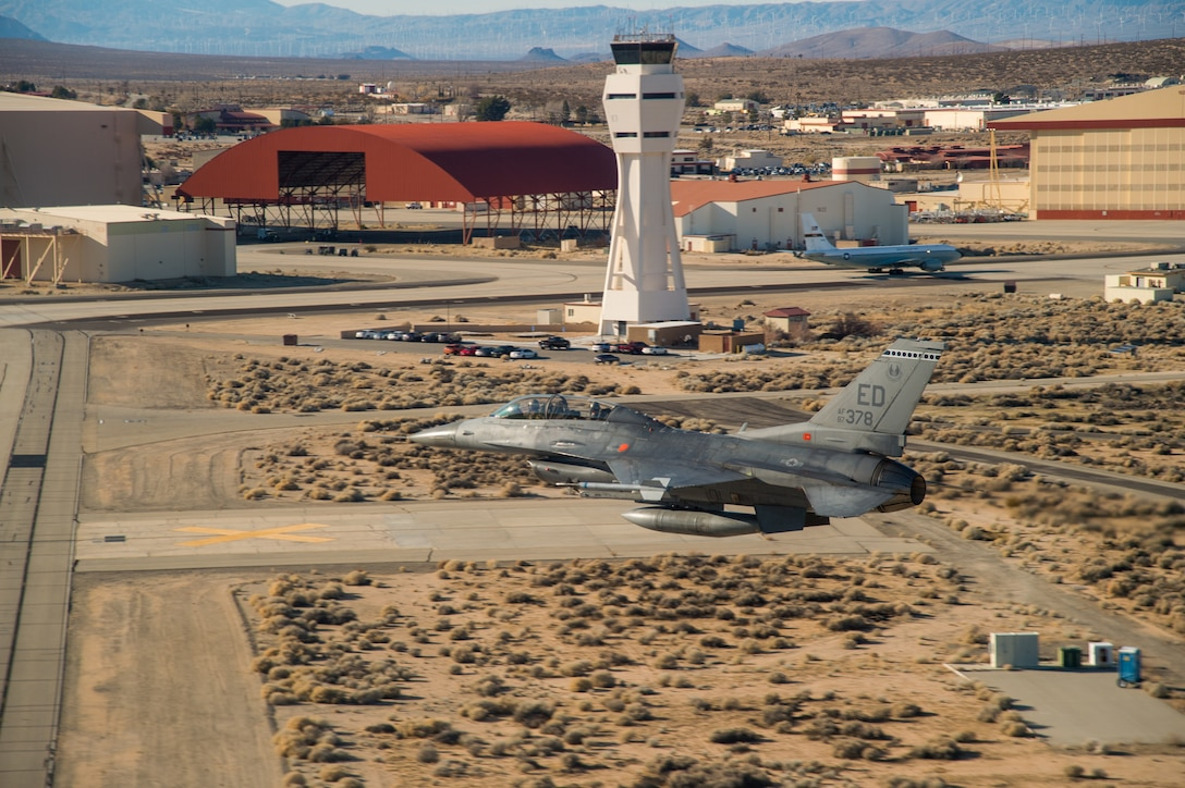 An F-16 Fighting Falcon from the 412th Test Wing's 416th Flight Test Squadron performs a fly-by of the air control tower at Edwards Air Force Base, California, Jan. 10. The 412th Test Wing will send a KC-135 and three F-16 Fighting Falcons to conduct a flyover for the NFC championship game at Levi's Stadium in Santa Clara, California, on Jan. 19. (Air Force photo by Ethan Wagner)
