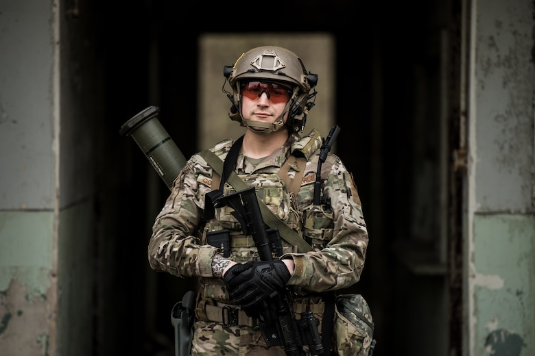 U.S. Air Force Staff Sgt. Estaban Gonawicha, 435th Security Forces Squadron ground combat readiness training center instructor, poses for a photo before exercise Frozen Defender in Grostenquin, France, Jan. 14, 2020. Frozen Defender tests the squadron's capabilities in a contested environment under harsh conditions. Gonawicha was equipped with an AT4, an 84-mm unguided anti-tank weapon, which could be used to disable armored vehicles. (U.S. Air Force photo by Staff Sgt. Devin Boyer)