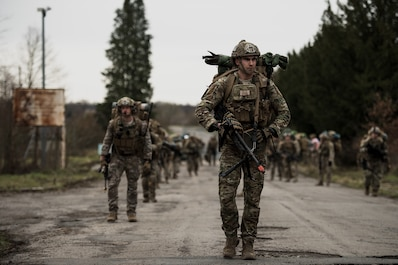 U.S. Air Force Staff Sgt. Quintan Ortega, 435th Security Forces Squadron contingency response fire-team leader, leads a squad to a rally point during exercise Frozen Defender in Grostenquin, France, Jan. 14, 2020. Frozen Defender tests the squadron's capabilities in a contested environment under harsh conditions. The training location is among several sites which are shared between the U.S., French and German air forces. (U.S. Air Force photo by Staff Sgt. Devin Boyer)