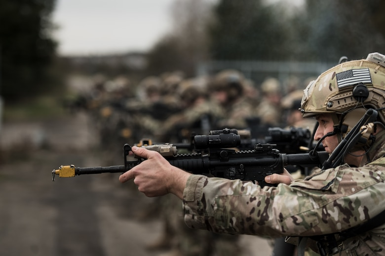 U.S. Air Force Staff Sgt. Andrew Tidwell, 435th Security Forces Squadron contingency response fire-team member, tests his rifle before exercise Frozen Defender in Grostenquin, France, Jan. 14, 2020. Frozen Defender tests the squadron's capabilities in a contested environment under harsh conditions. Tidwell and his comrades were equipped with blank rounds to improve the realism and immersion of the training. (U.S. Air Force photo by Staff Sgt. Devin Boyer)