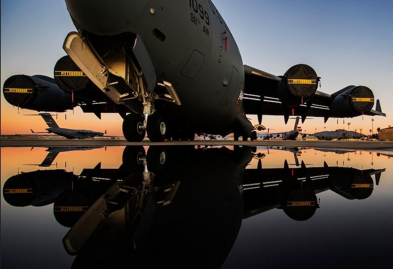 A C-17 Globemaster III sits on the flightline