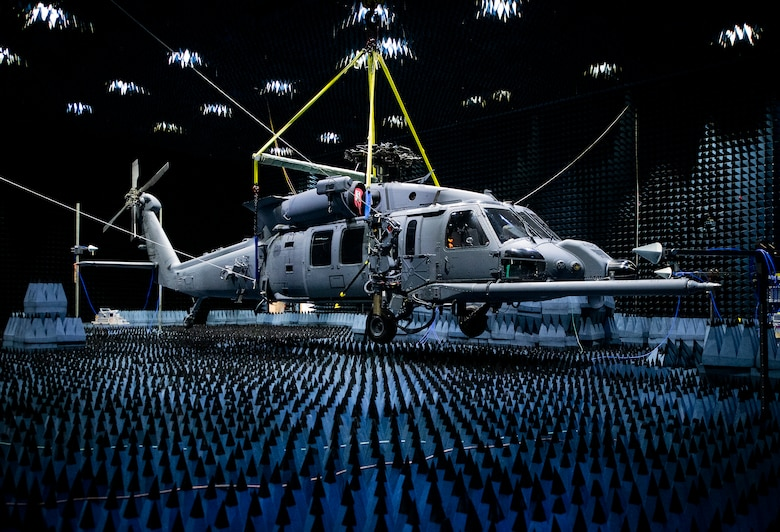 An HH-60W Pave Hawk hangs in the anechoic chamber