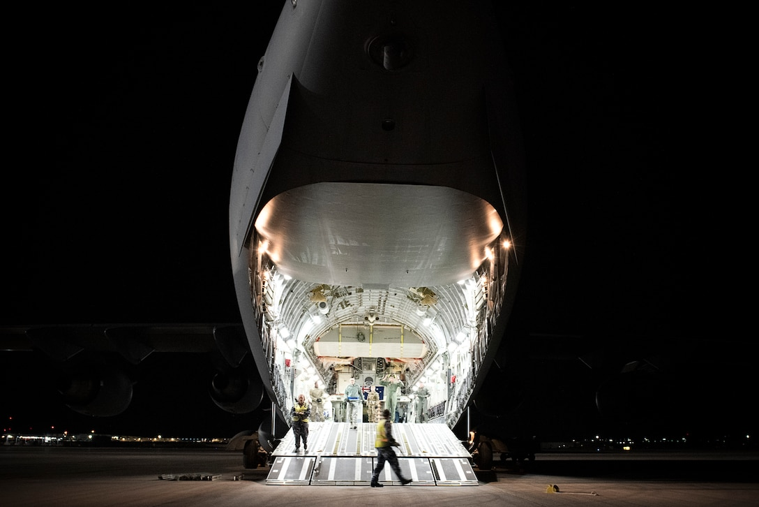 An aircraft is being loaded.