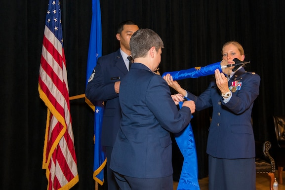 Col. Heidi A. Paulson, Air Force Manpower Analysis Agency commander, Lt. Col. Jessica Corea, 1st Manpower Requirements Squadron commander, and Master Sgt. Waymon Brown, Jr., 1st MRS NCO in charge of A-branch, furl the unit flag during the inactivation ceremony Jan. 9, 2020, at Joint Base San Antonio-Randolph, Texas. It is military custom to furl and encase the flag upon the completion of the organization's mission.