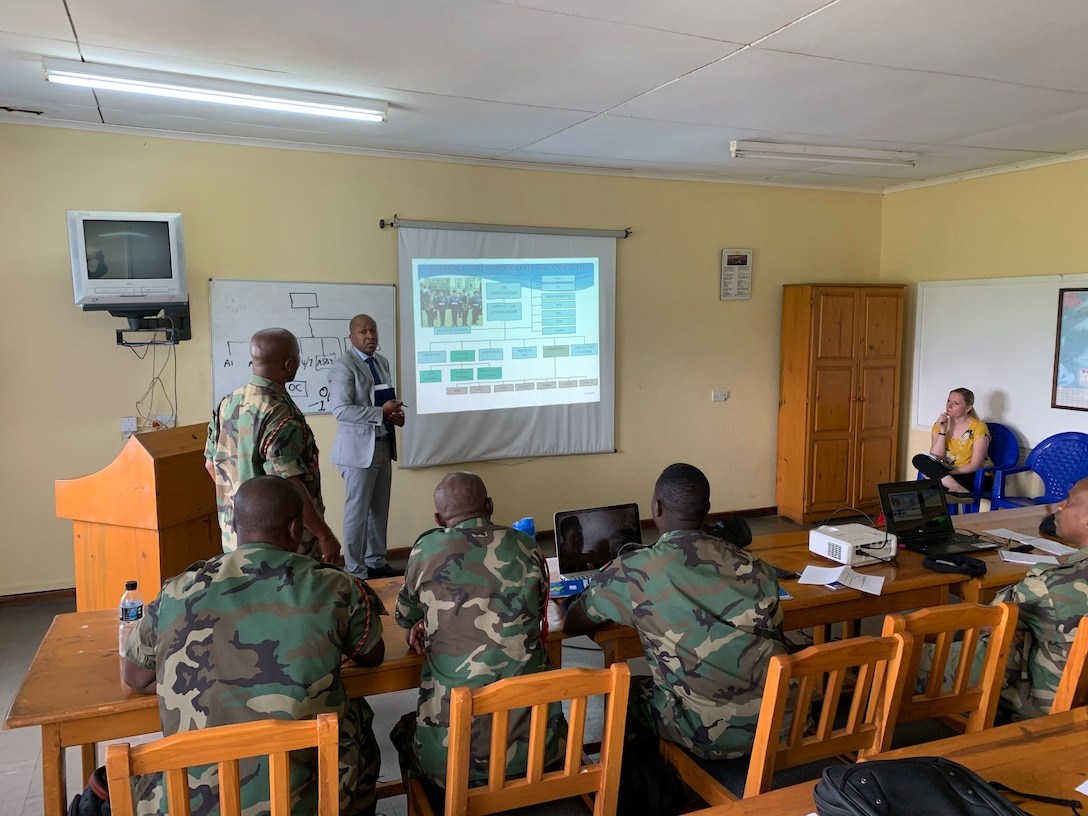 Noel Fachi, U.S. Air Forces in Europe and Air Forces Africa Manpower, Personnel and Services Directorate, Force Development team, briefs continuous process improvement to members of the Malawian air force at Lilongwe Air Base, Malawi, Jan. 14, 2020. Fachi leads a force development team that has been working with the Malawian air force since 2018 to build partnership capacity in the region. (U.S. Air Force photo by Capt. Korey Fratini)