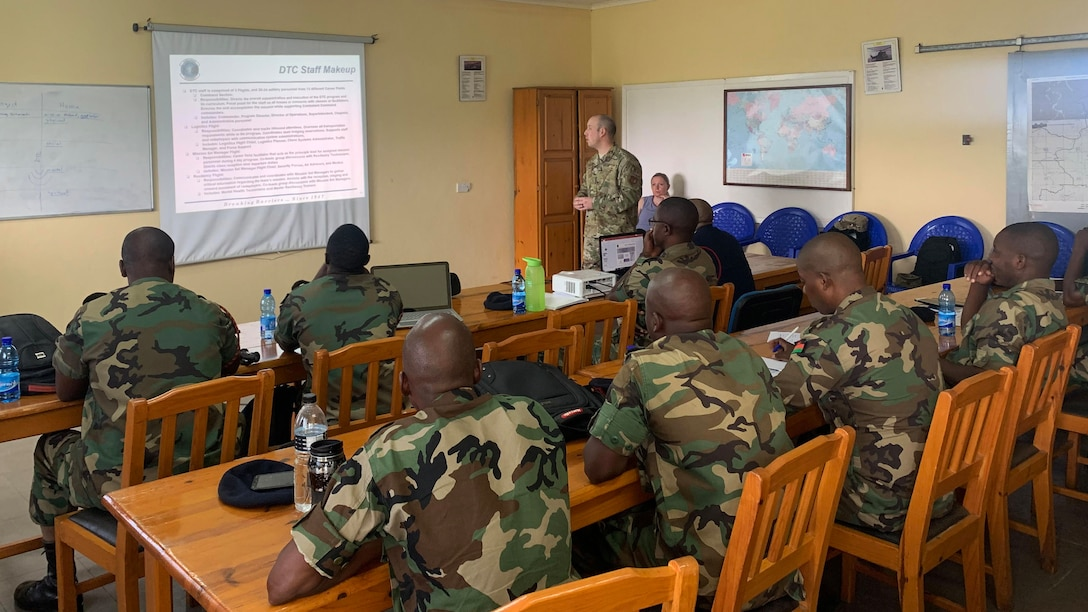 MSgt. Brandon Owens, superintendent, 86th Mission Support Group Detachment 1, Air Force Deployment Transition Center, briefs members of the Malawian air force on the U.S. Air Force's sole third location decompression program at Lilongwe Air Base, Malawi, Jan. 16, 2020. Rodriguez went to Malawi in support of the USAFE-AFAFRICA force development team that has been working with the Malawian air force since 2018 to build partnership capability in the region. (U.S. Air Force photo by Capt. Korey Fratini)