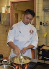 Staff Sgt. Marc Susa, U.S. Army Culinary Arts Team (USACAT) captain, prepares braised fennel as practice for the upcoming World Culinary Olympics in Stuttgart, Germany. USACAT will compete at the international competition as part of Team USA. (U.S. Army photo by Sarah Hauck)
