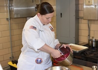Staff Sgt. Samantha Poe, member of the U.S. Army Culinary Arts Team (USACAT), prepares a chocolate beet cake as practice for the upcoming World Culinary Olympics 2020 in Stuttgart, Germany in February. USACAT will be part of Team USA competing against culinary teams from around the world.(U.S. Army photo by Sarah Hauck)
