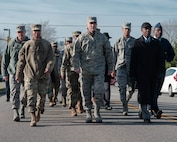 U.S. Air Force Airmen from Joint Base Langley-Eustis, Virginia, and community leaders, engage in a unity walk before a ceremony honoring the life and legacy of Dr. Martin Luther King Jr., Jan. 17, 2019. During the unity walk, participants played speeches from Dr. Martin Luther King Jr.'s life. (U.S. Air Force photo by Airman 1st Class Marcus M. Bullock)