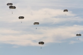 Airborne Soldiers deploy parachutes during airborne drop training.