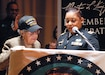 Maj. Lakisha Hale-Earle, chief of G1 plans and training for U.S. Army Reserve's 99th Readiness Division (right), pays tribute to former Sgt. Hilda P. Griggs, who served in the Second World War's 6888th Central Postal Directory Battalion (left), during New Jersey's annual Martin Luther King Jr. commemoration Jan. 19 at the N.J. State Museum Auditorium in Trenton. The 6888th was the first-and-only all-African American, all-female unit to deploy overseas during the war. It consisted of 855 women under the command of Lt. Charity Adams, the first African-American woman commissioned in the Women's Army Corps. (U.S. Army photo by Sgt. Sal Ottaviano)