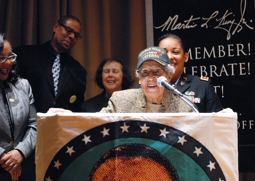 Former Sgt. Hilda P. Griggs, who served in the Second World War's 6888th Central Postal Directory Battalion, delivers remarks during New Jersey's annual Martin Luther King Jr. commemoration Jan. 19 at the N.J. State Museum Auditorium in Trenton. The 6888th was the first-and-only all-African American, all-female unit to deploy overseas during the war. It consisted of 855 women under the command of Lt. Charity Adams, the first African-American woman commissioned in the Women's Army Corps. (U.S. Army photo by Sgt. Sal Ottaviano)