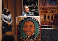 Maj. Lakisha Earl-Hale, G-1 chief of plans for the U.S. Army Reserve's 99th Readiness Division, delivers remarks during New Jersey's annual Martin Luther King Jr. commemoration Jan. 19 at the N.J. State Museum Auditorium in Trenton. Honored during the ceremony was former Sgt. Hilda P. Griggs, who served in the Second World War's 6888th Central Postal Directory Battalion. The 6888th was the first-and-only all-African American, all-female unit to deploy overseas during the war. It consisted of 855 women under the command of Lt. Charity Adams, the first African-American woman commissioned in the Women's Army Corps. (U.S. Army photo by Sgt. Sal Ottaviano)