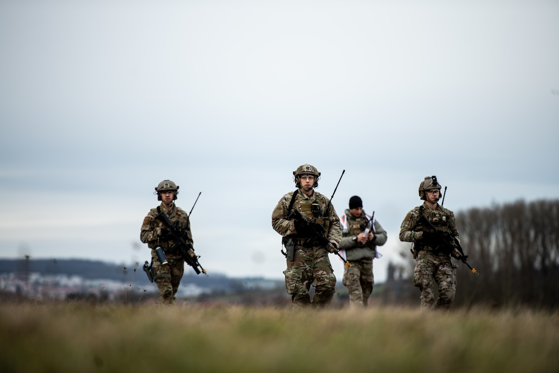 Photo of security forces Airmen patrolling an airfield.