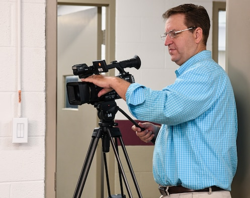 David Wright, who works in Public Affairs, shoots video at Arnold Air Force Base. (U.S. Air Force photo by Jill Pickett)