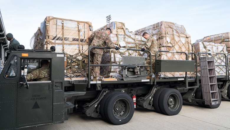 Members of the 436th Aerial Port Squadron, Dover Air Force Base, Del., and Army's 622nd Movement Control Team, Joint Base Langley-Eustis, Va., engage cargo pallet locks on a 60-ton K-loader Jan. 10, 2020, on Dover Air Force Base, Del. In a scheduled joint partnership training event, 16 members from the 622nd MCT came to Dover AFB for cargo and personnel processing training. (U.S. Air Force photo by Roland Balik)
