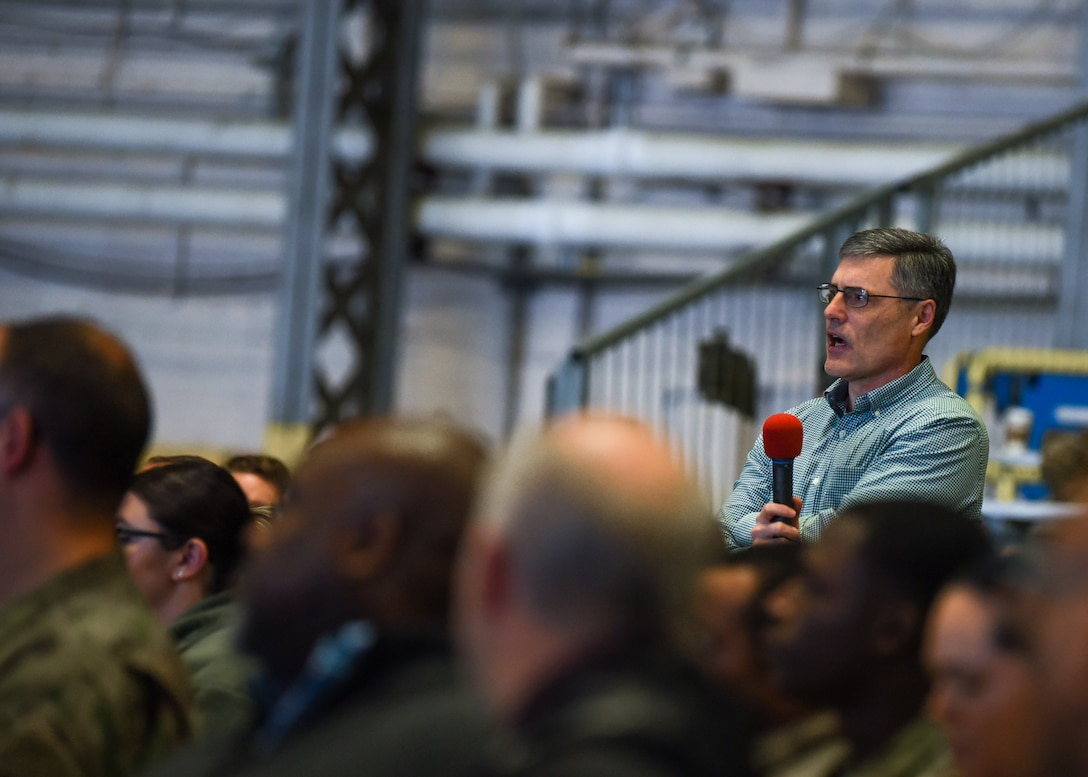 Greg Endris, 62nd Airlift Wing deputy chief of wing plans and programs, asks a question during a commander's call at Joint Base Lewis-McChord, Wash., Jan. 16, 2020. Commander's calls are an opportunity for leadership to address their Airmen face to face. (U.S. Air Force photo by Staff Sgt. Joshua Smoot)