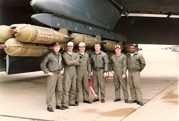 Airmen pose outside a B-52 back in 1991.